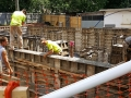Pouring cement into the wall forms